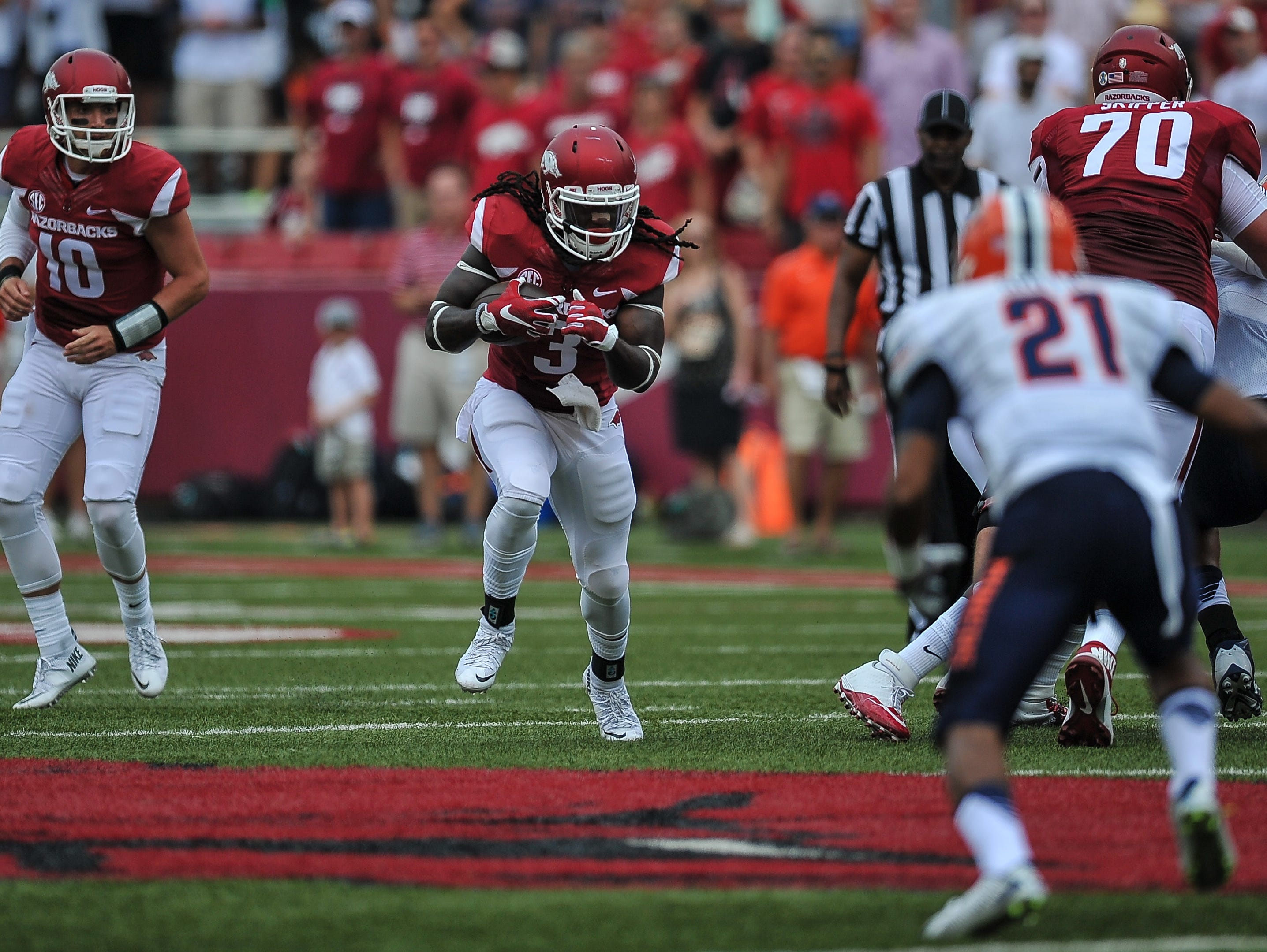 Arkansas Razorbacks running back Alex Collins (3) runs with the ball during a football game between the Arkansas Razorbacks and the UTEP Miners on Saturday, September 5, 2015 at the Donald W. Reynolds Razorback Stadium in Fayetteville, Arkansas. Arkansas won the game 48-13.