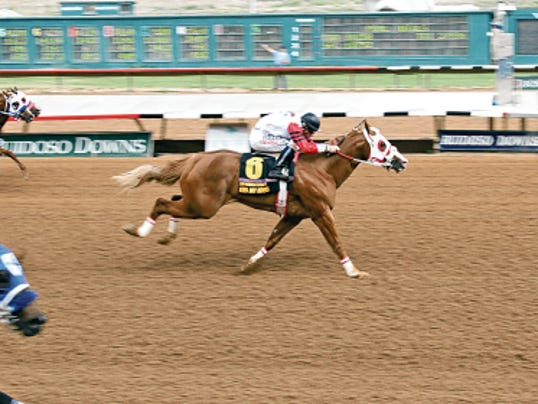 Jockey Cody Jensen, pictured here winning the 2014 Ruidoso Futurity aboard champion Kiss My Hocks, was transported to the University of New Mexico hospital Sunday after sustaining injuries during training Friday.