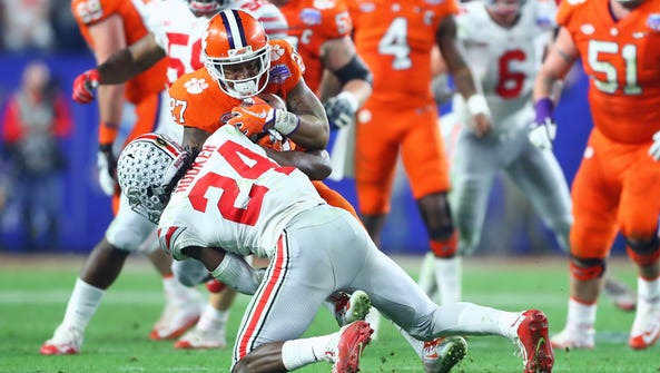 Ohio State safety Malik Hooker tackles Clemson  running