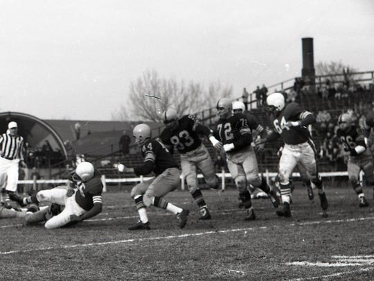 Green Bay Packers linebacker Deral Teteak (66 at far right) gives chase as San Francisco 49ers halfback John Henry Johnson (35) is tackled at old City Stadium on Nov. 18, 1956. In front of Teteak are, from left, Packers safeties Val Joe Walker (47) and Bobby Dillon (44), defensive end John Martinkovic (83), defensive tackle Jerry Helluin (72) and 49ers guard Ted Connolly (64). The Packers lost 17-16. It was the last NFL game played at old City Stadium.