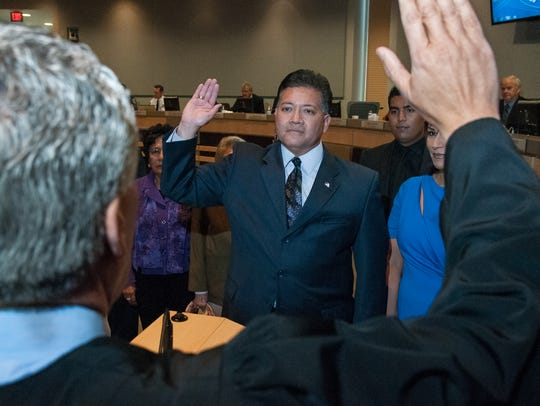 Mayor Ken Miyagishima is sworn-in at City Hall in 2016 — marking the start of his third consecutive term in office. Currently, mayors serve four-year terms and there are no term limits.