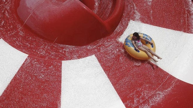 A visitor at Rapids Water Park rides the Big Red.