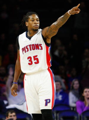 Detroit Pistons forward Cartier Martin points down the court against the Philadelphia 76ers at the Palace of Auburn Hills.