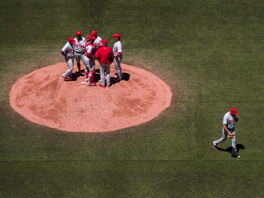 Philadelphia Phillies pitcher Zach Eflin leaves the game after he was taken out against the Toronto Blue Jays during the third inning of an interleague baseball action in Toronto, Tuesday, June 14, 2016. (Mark Blinch/The Canadian Press via AP)