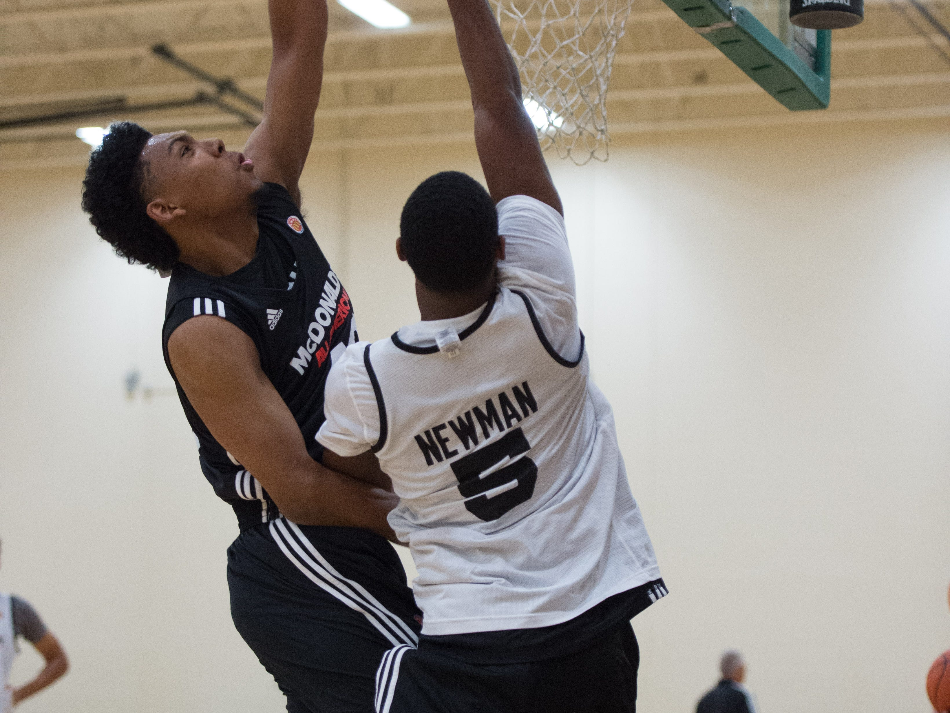 Callaway's Malik Newman goes up to block Arizona commit Allonzo Trier's shot during practice.