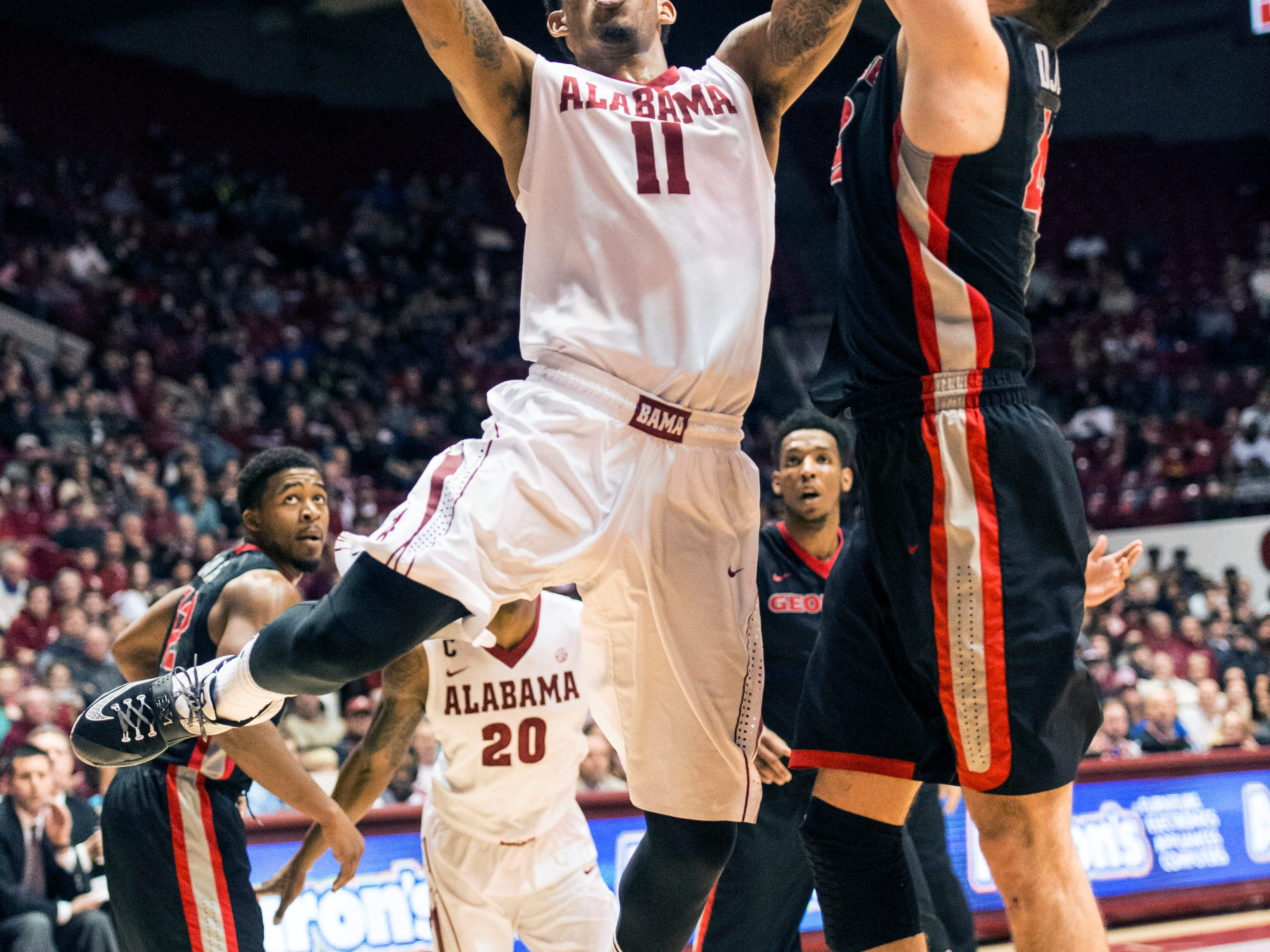 Alabama forward Shannon Hale (11) pushes the ball to the basket against Georgia during an NCAA college basketball game, Saturday, Feb. 21, 2015, at Coleman Coliseum in Tuscaloosa, Ala. (AP Photo/AL.com, Vasha Hunt) MAGS OUT