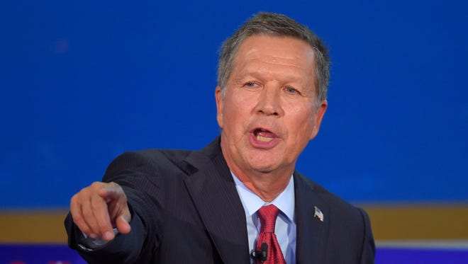 "Ohio Gov. John Kasich speaks during the CNN Republican presidential debate on Wednesday, Sept. 16, 2015, in Simi Valley, Calif. Kasich joked on ""Late Night"" that the debate was a ""demolition derby."""