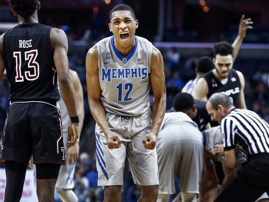 University of Memphis guard Craig Randall II (middle) celebrates after creating a Temple University turnover during second half action at the FedExForum.