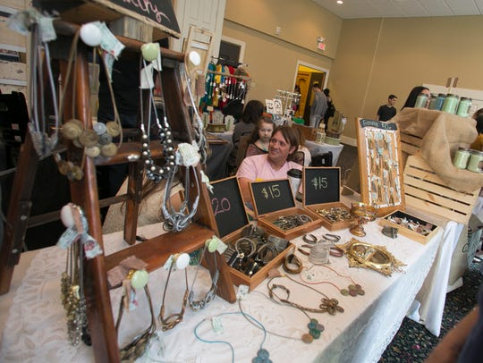 Jewelry is displayed during the seventh annual Market