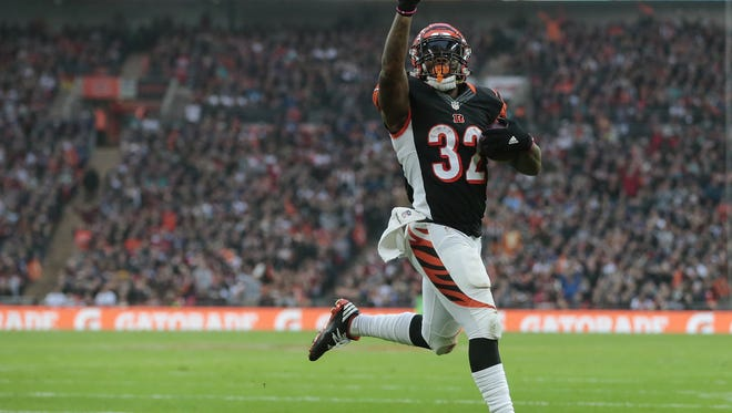 Cincinnati Bengals running back Jeremy Hill (32) scores a touchdown in the fourth quarter during the NFL International Series game between Washington and the Cincinnati Bengals, Sunday, Oct. 30, 2016, at Wembley Stadium in London, England. The game ended in a 27-27 tie.