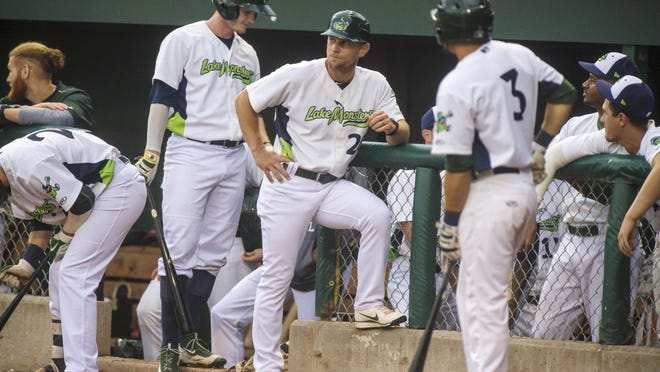 Lake Monsters Manager Aaron Nieckula, center, leads his team against the Hudson Valley Renegades at Centennial Field in Burlington on Friday, July 7.