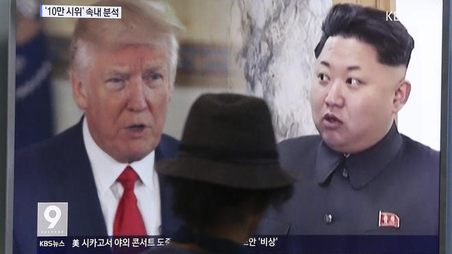In this Aug. 10 photo, a man watches a television screen showing U.S. President Donald Trump and North Korean leader Kim Jong Un during a news program at the Seoul Train Station in Seoul, South Korea.