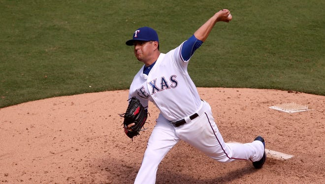 Texas Rangers relief pitcher Cesar Ramos works against the Minnesota Twins on July 10, 2016, at Globe Life Park in Arlington, Texas.
