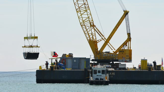 Workers were installing artificial reefs behind the Radisson Suite Hotel Oceanfront Thursday morning. Brevard County is putting the articulated concrete mats, with embedded coquina rock just offshore, to make up for any buried natural reef during renourishment of Satellite Beach and Indian Harbour Beach. County officials say their plan to renourish those depleted shorelines in late 2018 or 2019 will try to spare unique natural reefs near the beach and that the artificial reef will compensate for any reef they bury.