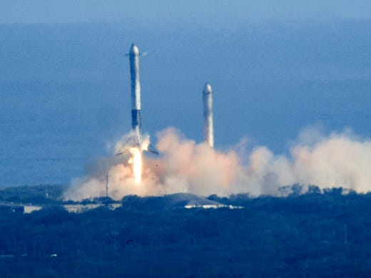 Two Boosters from SpaceX Falcon Heavy Rocket Land