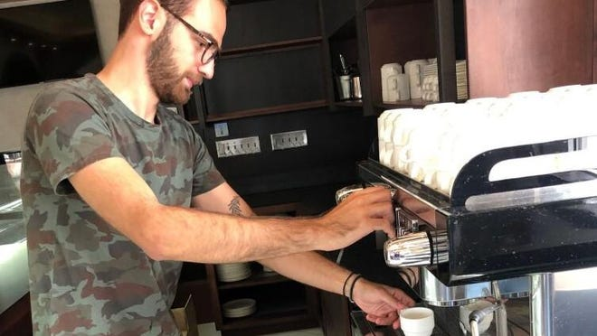 George Kostantinis works in Zea Zeo Coffee inside Kozi Italian Kitchen. The restaurant will be opening soon.