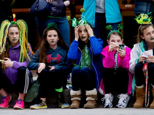 Kids watch as the parade passes during the Knoxville St. Patrick's Day Parade in downtown Knoxville, Tennessee on Friday, March 17, 2017. After an almost 30-year absence, the Knoxville St. Patrick's Day parade returned in 2017.