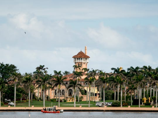 Mar-a-Lago is visible from a motorcade carrying President Donald Trump, in Palm Beach, Florida.