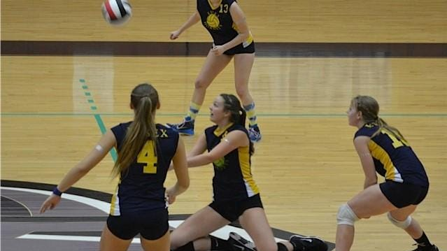 Essex's Taylor Truex, center, hits the ball, surrounded by teammates Amanda Sinkewicz (left), Jordan Dumouchel (top) and Emily Goodrich at Saturday's volleyball finals.