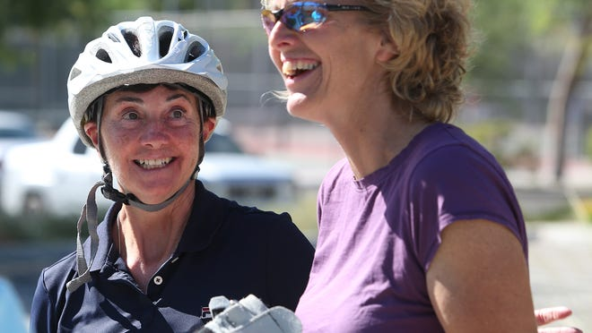 Angie DiPrinzio and physical therapist Dawne Harris (right) laugh as they get Angie ready for her first ride on a recumbent cycle. Once an avid cyclist, Angie suffered a stroke in 2008, and is hoping to use a recumbent bike as a main part of her rehabilitation.