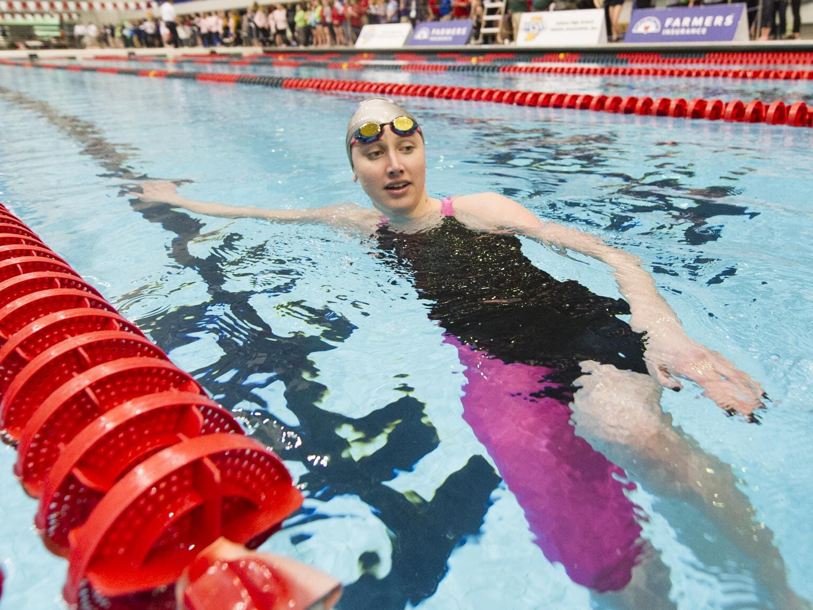 Carmel's Amy Bilquist cools down in the pool after winning the 100 Yard Freestyle event at 41st Annual IHSAA Girl's Swimming and Diving State Finals, Feb. 14, 2015, at IUPUI Natatorium in Indianapolis.