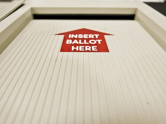 A vote counting machine at Essex High School in 2010.