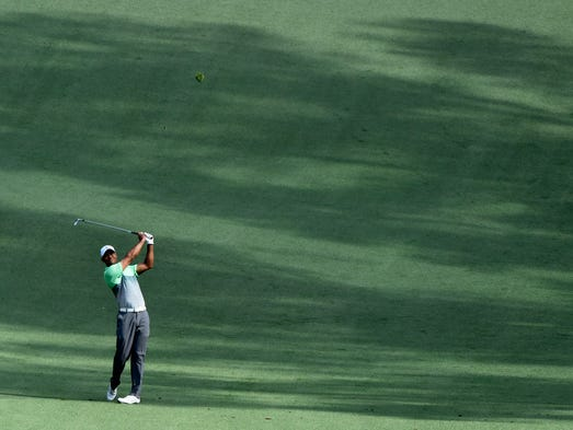 tiger woods gets in practice time at augusta national