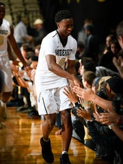 Vanderbilt guard Saben Lee (0) celebrates a 73-54 win against Austin Peay with fans at Memorial Gymnasium on Nov. 10.