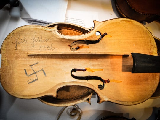 "A violin whose interior was parted in the 1930s with ""Heil Hitler"" and with a swastika is part of the ""Violins of Hope"" but will not be restored."