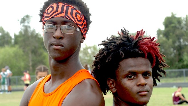 Desmond Davis, left, and Seneca Milledge are budding stars for the Dunbar track team.