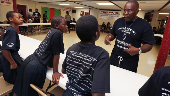Rev. Malachi Walker of Great Commission Church of God conducts his African American Male Empowerment Camp at the church, 3302 Arsenal Ave. Walker, who founded Young Men Inc. in 1993, was one of six fathers honored by the Fathers and Families Center in Indianapolis at the Faces of Fatherhood luncheon on Friday, June 19, 2015.