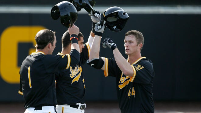 Iowa outfielder Robert Neustrom, right, celebrates his second-inning, two-run homer in a 12-3 win over Northern Illinois.