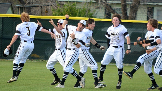 Abilene High players celebrate after the Eagles' 7-6 walk-off win over Keller Fossil Ridge on Friday at Blackburn Field.