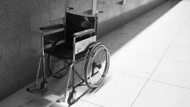 An empty wheelchair sit abandoned.