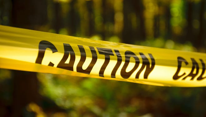 Caution yellow tape in woods