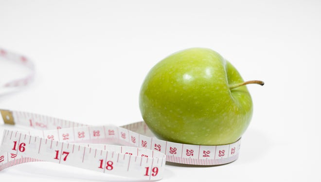 Green apple with measurement.
