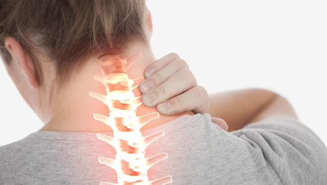 Constantly sitting with our heads bent forward over electronic devices can cause neck pain.