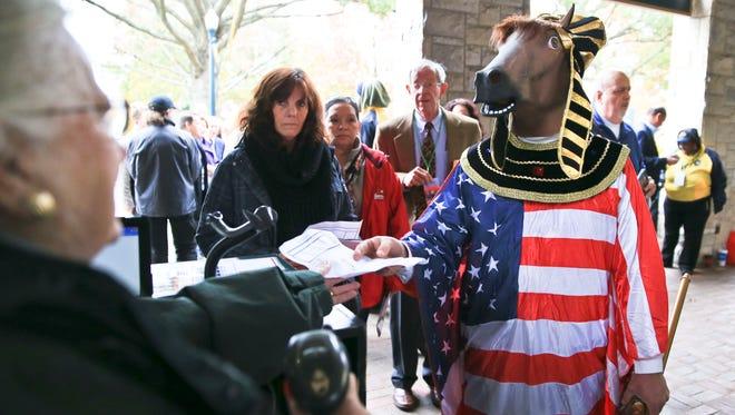 American Pharoah -- Alan Hincks of Louisville -- checks in at the Breeders' Cup Saturday at Keeneland. He wanted to honor his favorite horse.