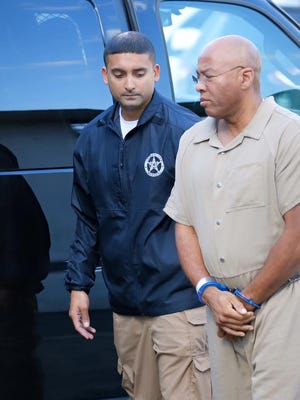 Richard Leon Wilbern, accused of the Xerox credit union robbery and homicide, arrives at federal court for earlier hearing.