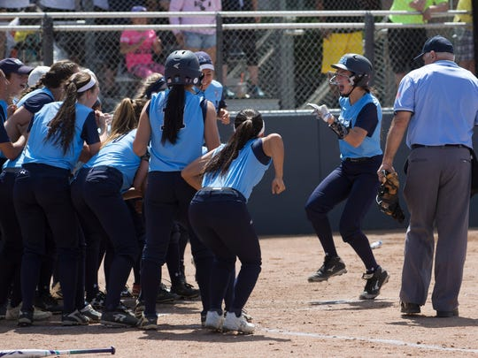 IHA's Mia Recenello heads for the plate and team mates after she hit a home run to put her team on the board. Donovan Catholic vs Immaculate Heart Academy for Non-Public A Softball Championship at Kean University in Union NJ on June 3, 2017.