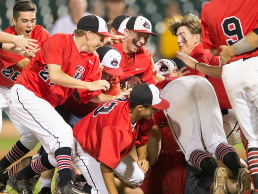 Cardinal Ritter High School players celebrate upon