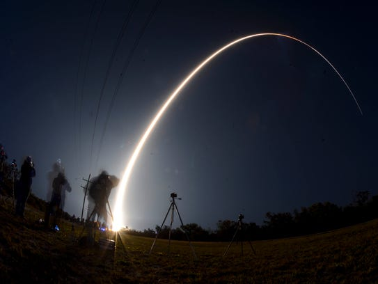 A Delta IV rocket blasts off from Cape Canaveral Air