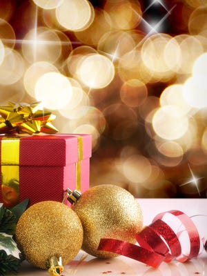 Golden Christmas decoration with two balls and gift.