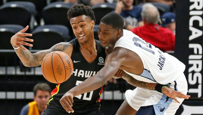 Memphis Grizzlies forward Jaren Jackson Jr. (13) and Atlanta Hawks forward John Collins (20) battle for a loose ball during the second half of an NBA summer league basketball game Monday, July 2, 2018, in Salt Lake City.