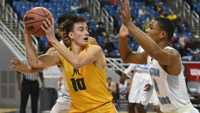 Bishop Manogue's Kolton Frugoli looks to pass the ball as he is double-teamed by Canyon Springs' Timothy Sayles, left, and Kevin Legardy, right, during Friday's 4A boys state semifinals in Reno.