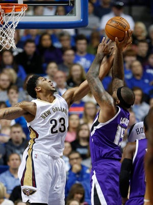 Oct 17, 2015; Lexington, KY, USA; New Orleans Pelicans forward Anthony Davis (23) defends against Sacramento Kings center DeMarcus Cousins (15) in the second half at Rupp Arena. Sacramento Kings defeated the New Orleans Pelicans 107-98. Mandatory Credit: Mark Zerof-USA TODAY Sports