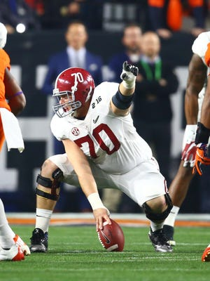 Alabama  center Ryan Kelly (70) directs his offensive linemates during the College Football National Championship  against Clemson on Jan. 11, 2016, at Glendale, Ariz.