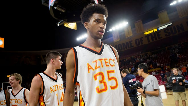 Corona freshman guard Marvin Bagley III walks off the court after Corona's win over Central during the boys basketball quarterfinal at Wells Fargo Arena, February 25, 2015 in Tempe, Arizona.