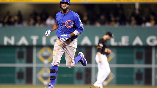 Dexter Fowler, #24 of the Chicago Cubs, runs the bases after hitting a solo home run in the fifth inning during the National League Wild Card game against the Pittsburgh Pirates on Oct. 7, 2015, in Pittsburgh.