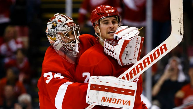 Detroit Red Wings goalie Petr Mrazek, left, restrains defenseman Brendan Smith during the third period of Game 3 against the Tampa Bay Lightning on April 17, 2016.